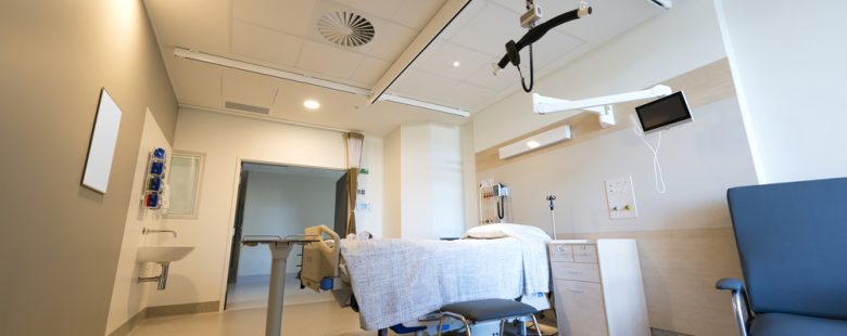 an empty white hospital room