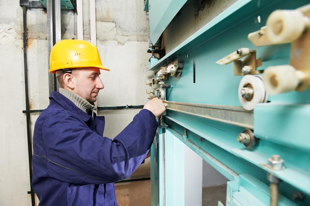 Lift Maintenance worker fixing lift