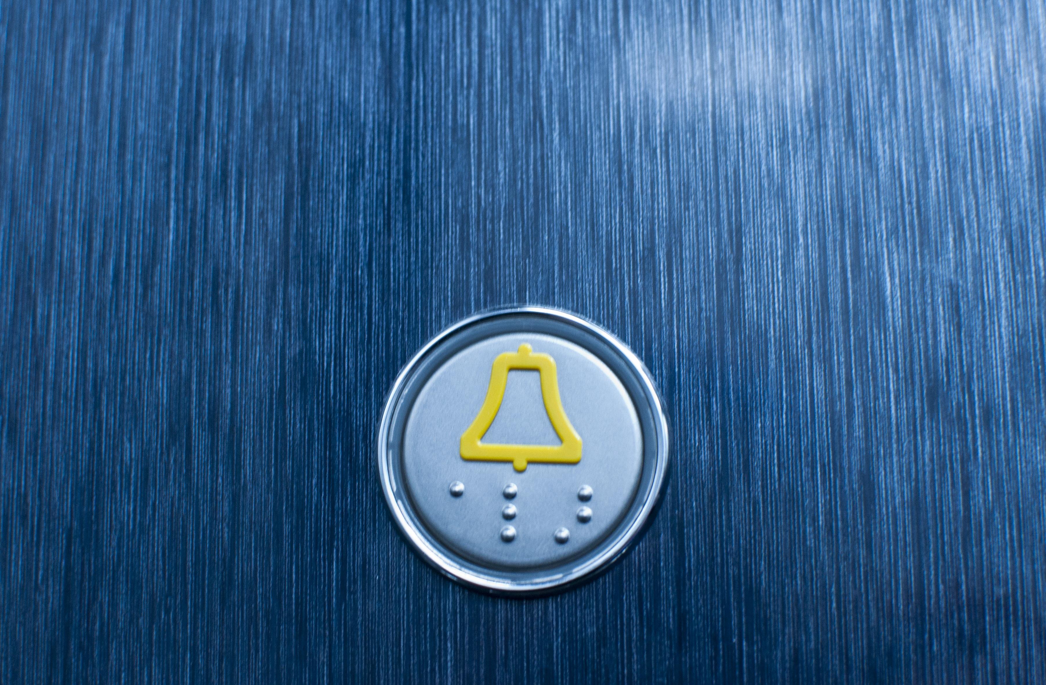 yellow lift alarm button