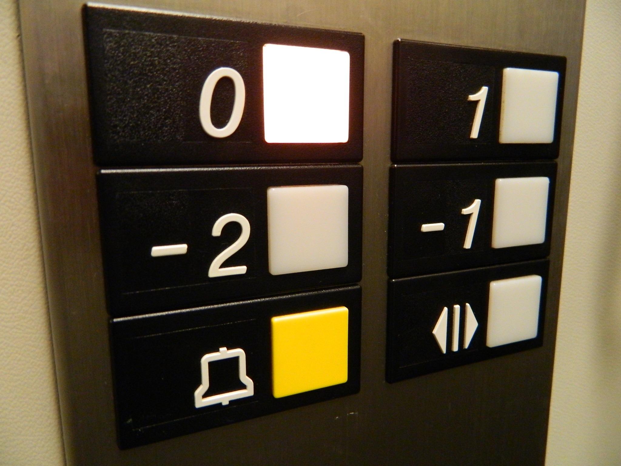 ground floor elevator button lit