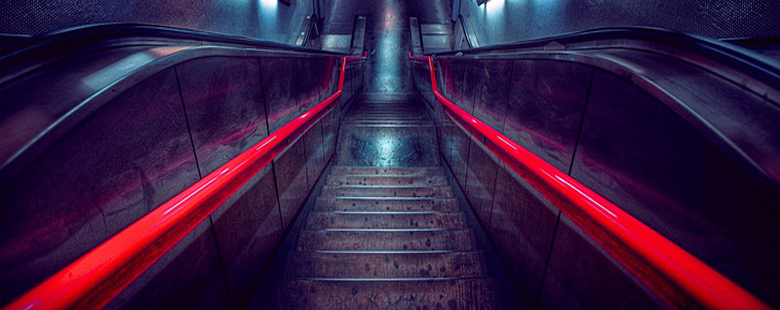 escalator with red hand rails
