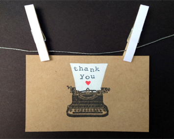 card saying thank you hanging on a line with pegs