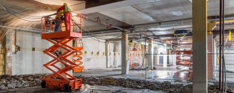 building under construction with scissor lift