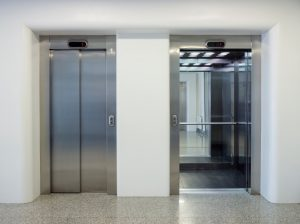 two lift doors, one open, one closed