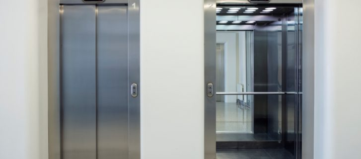 two elevator doors, one open, one closed