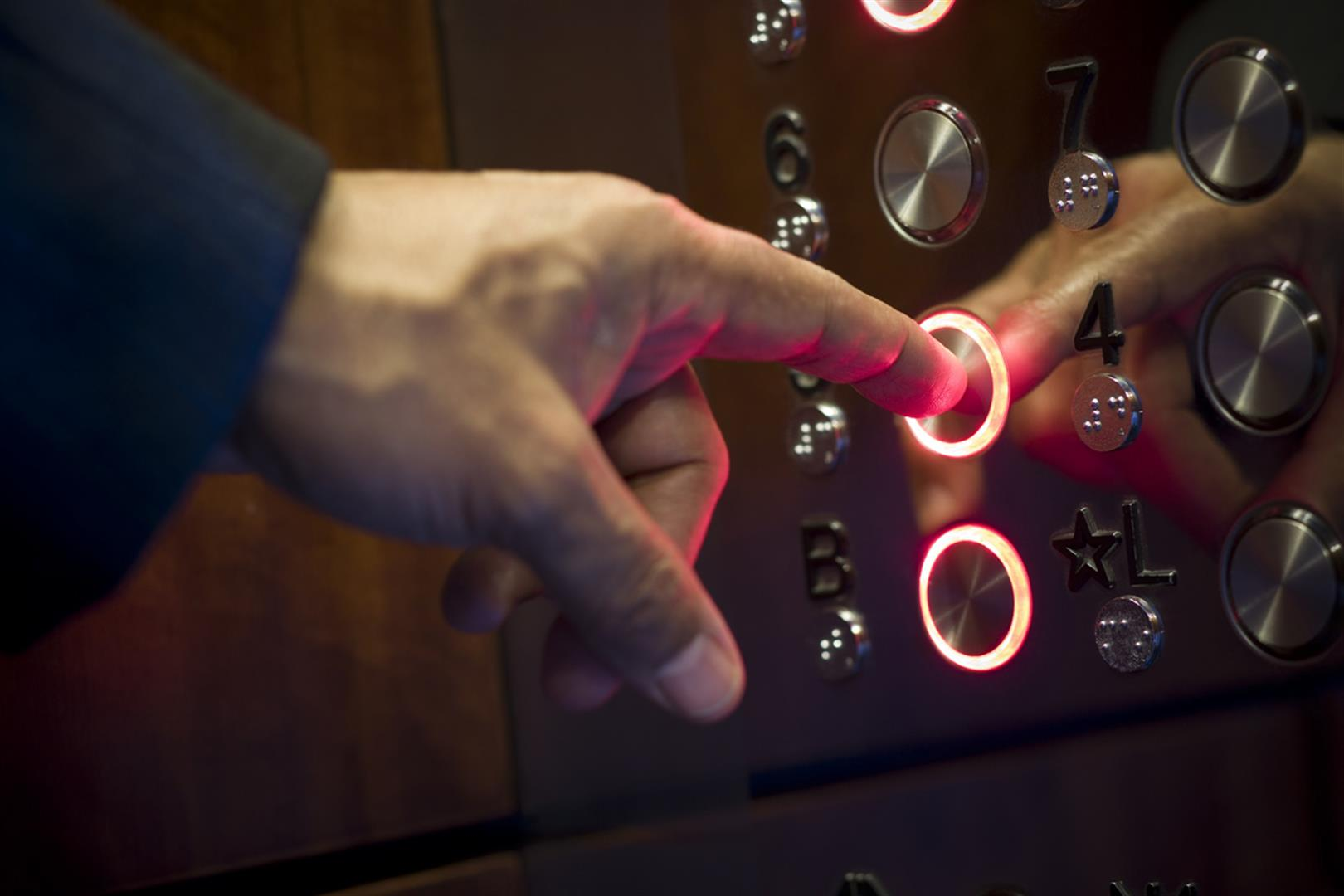 finger on lift button