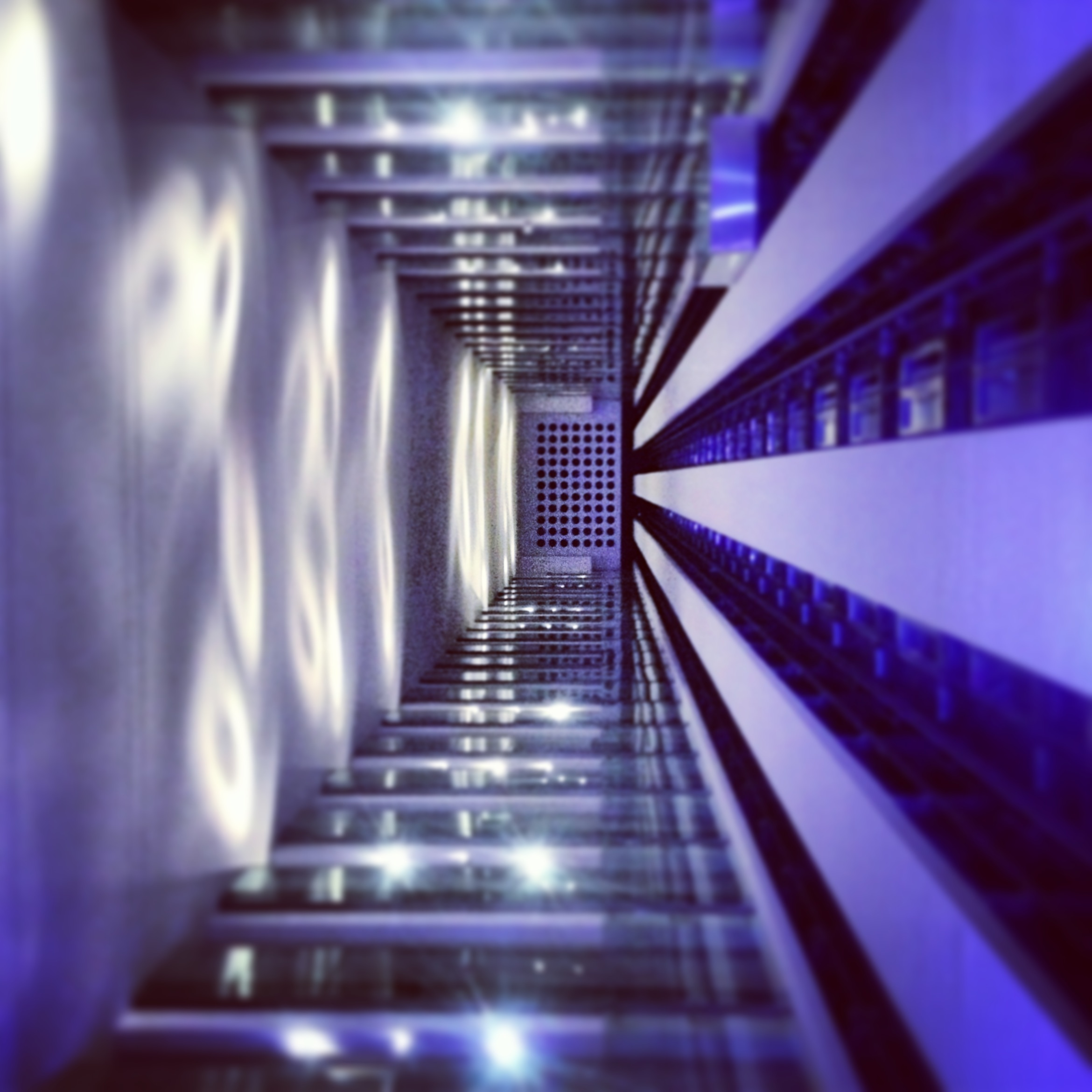 Looking down an urban and modern elevator, lift