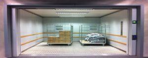 two trolleys inside a goods lift